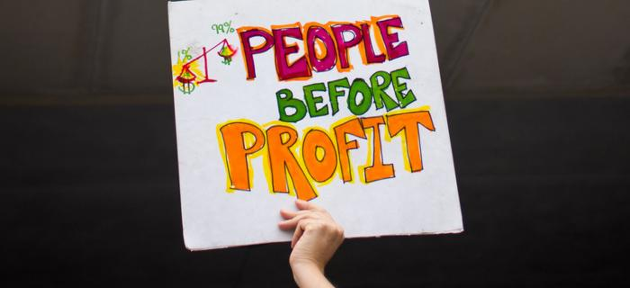 People before profit sign in front of bank of america